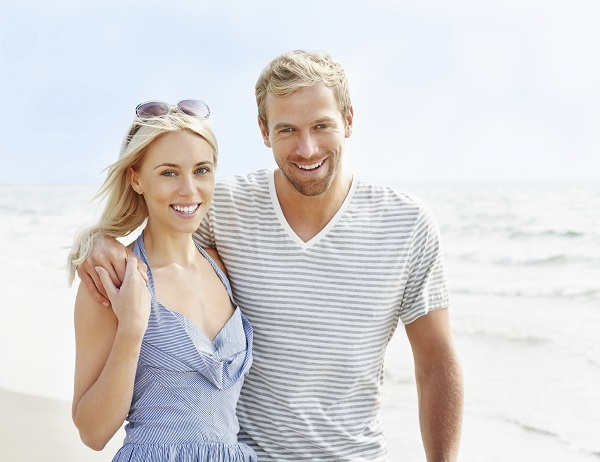 Couple on a California beach after LASIK